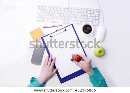 Directly above shot of a lawyer, notary stamping the document, while sitting at desk. Isolated on white background. Personal view. - stock photo