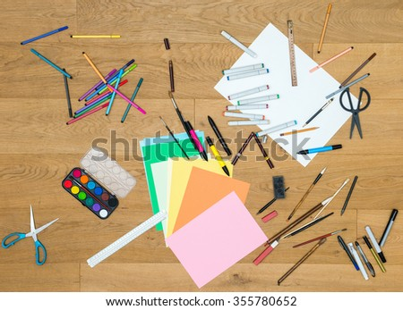 Directly above shot of art and craft tools on wooden table - stock photo