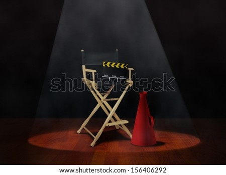 Director Chair with Clapper and Megaphone - stock photo