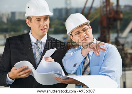 Director is showing a place of construction to the architect - stock photo
