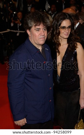 Director PEDRO ALMODOVAR & date at the Cannes Film Festival for the premiere of Femme Fatale. 25MAY2002.  Paul Smith / Featureflash