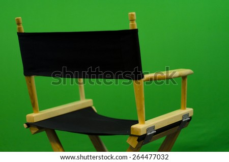 Director's chair in front of green screen Close Up - stock photo