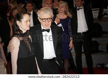 Director Woody Allen and his wife Soon-Yi Previn depart the Premiere of 'Irrational Man' during the 68th annual Cannes Film Festival on May 15, 2015 in Cannes, France. - stock photo
