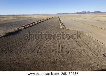 dirt fields - stock photo