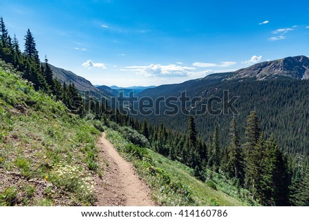 Dirt hiking trail through the Colorado Rocky Mountains - stock photo