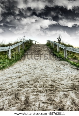 Dirt road and dramatic skies HDR - stock photo