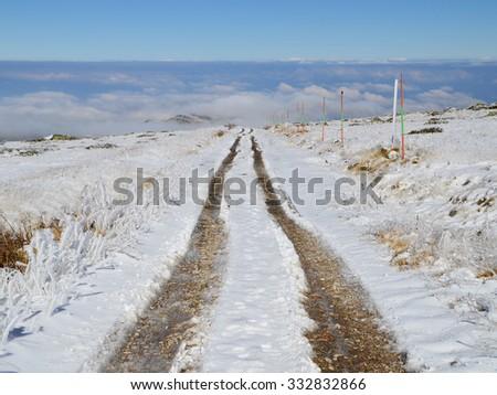 Dirt Road High in the Snowy Vitosha Mountain - stock photo