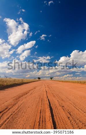 Dirt road in Australian rural outback tire print red soil - stock photo