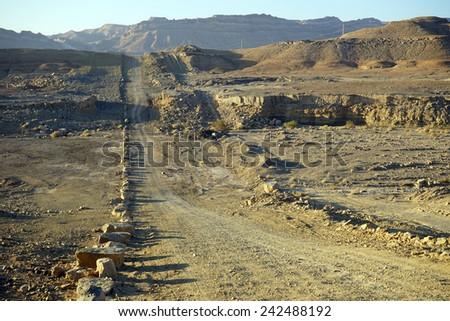Dirt road in crater Ramon in Negev desert, Israel                                 - stock photo