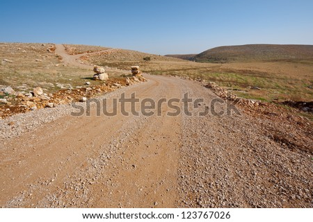 Dirt Road in the Judean Mountains on the West Bank of the Jordan River - stock photo
