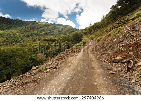 Dirt road leading through Chin State in Myanmar (Burma) - stock photo