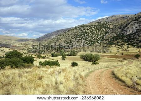 Dirt road near mountain, Turkey                                 - stock photo