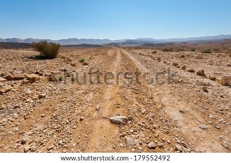 Dirt Road of the Negev Desert in Israel - stock photo