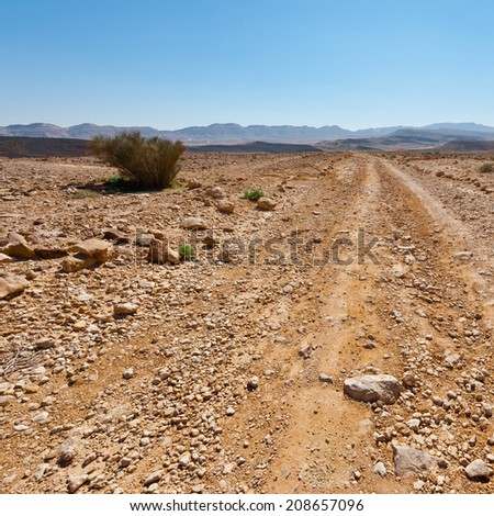 Dirt Road of the Negev Desert in Israel - stock photo