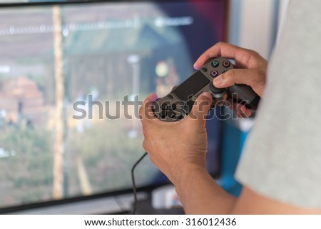 Dirty and damaged hands worn from playing too many computer/video games. - stock photo