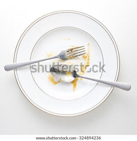 dirty and empty dishes with spoon and fork. - stock photo