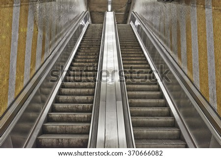 Dirty and grungy escalator from Brussels subway - stock photo
