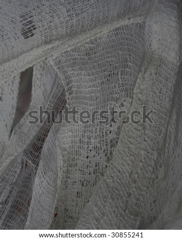Dirty bandage on the metall construction. Old background. - stock photo