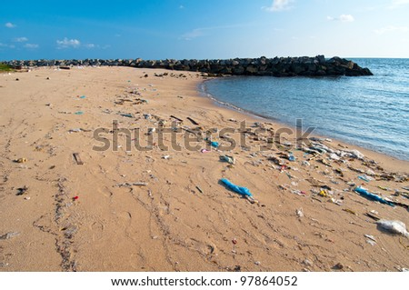 Dirty beach on blue sky. Thailand - stock photo