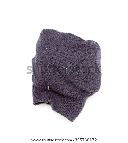 dirty black socks on a white background