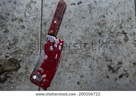 Dirty cleaver cover with blood - stock photo