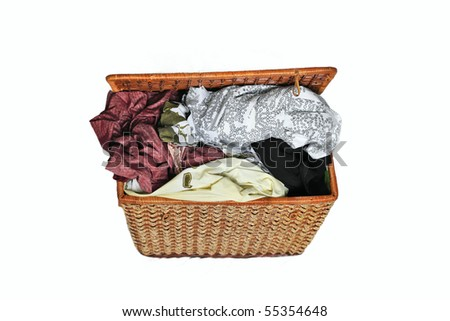 dirty clothes in the basket isolated over white background - stock photo