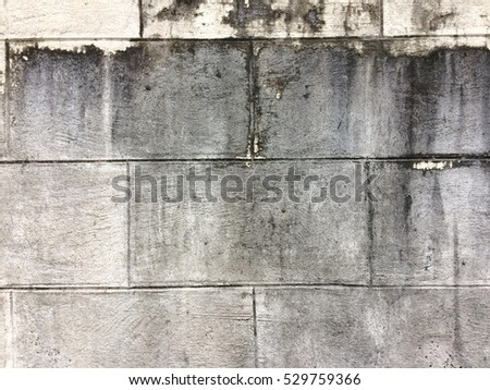 Dirty dark cement block wall texture background