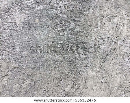Dirty dark rough cement wall background texture