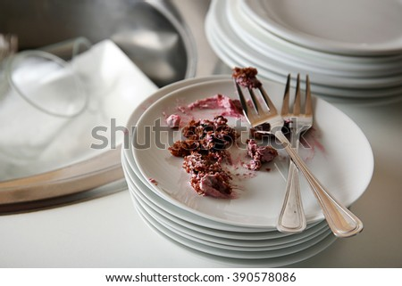 Dirty dishes and kitchen sink closeup - stock photo