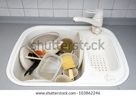 dirty dishes in kitchen - stock photo