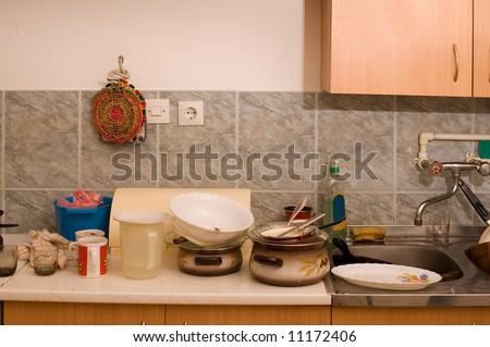 Dirty dishes on sink in the kitchen - stock photo