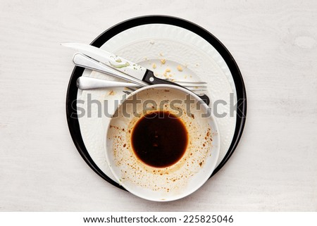 Dirty dishes on white table - stock photo