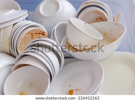 Dirty dishes waiting for wash. - stock photo