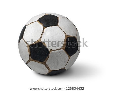 Dirty football isolated with clipping path - stock photo