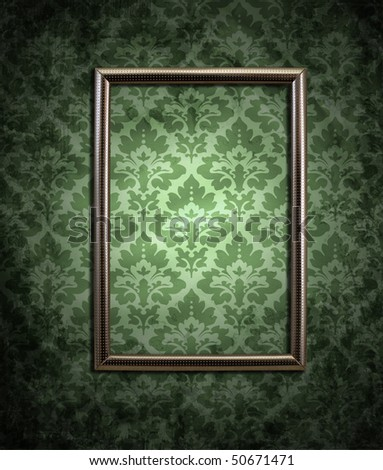 dirty green wallpaper and an empty frame - stock photo