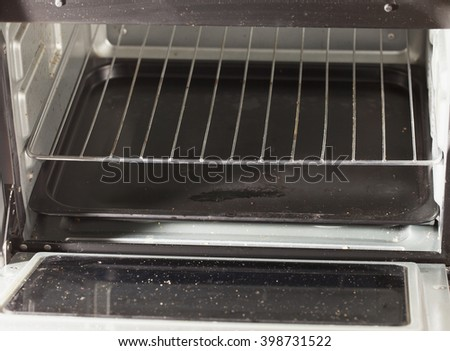 Dirty grill of electric oven, horizontal image - stock photo