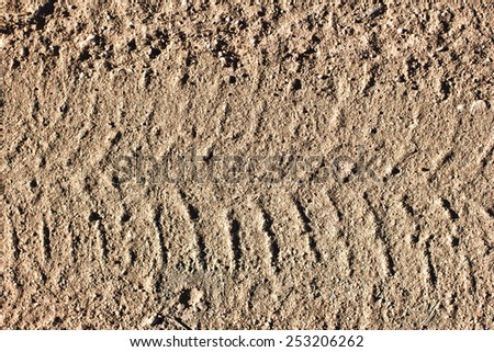Dirty grunge tyre track on sand texture. - stock photo