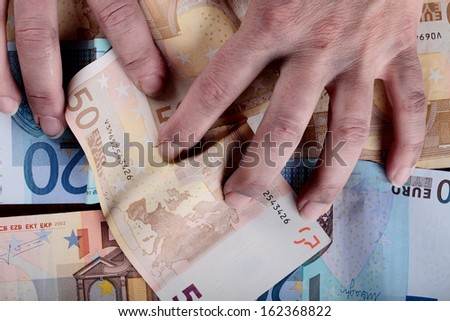 dirty hands grabbing Euro banknotes - stock photo
