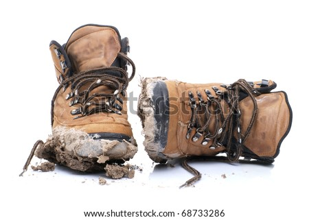 dirty hiking boots - stock photo