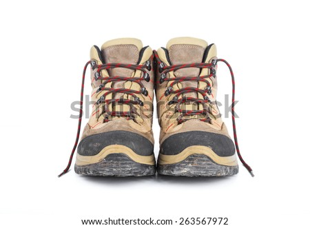 Dirty hiking boots isolated on white background. - stock photo