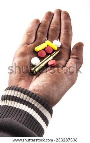 dirty human hand holding pills and bullet isolated on white background - stock photo