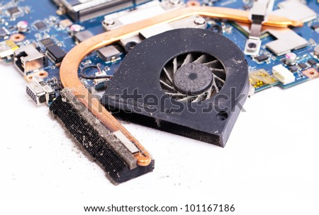 Dirty laptop cooling system close view on details - stock photo