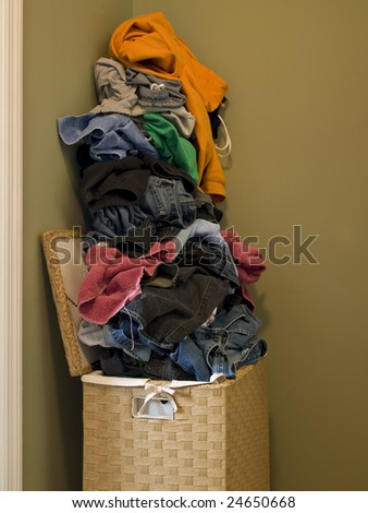 Dirty Laundry in Clothes Hamper side view - stock photo