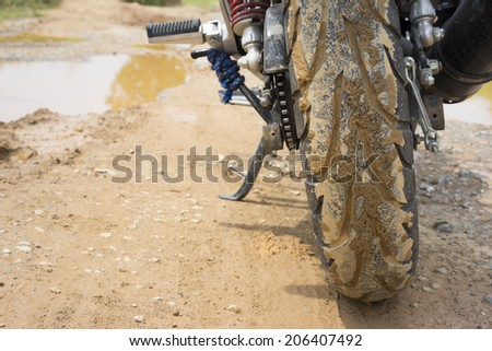 Dirty off-road tire after passing a mud terrain area