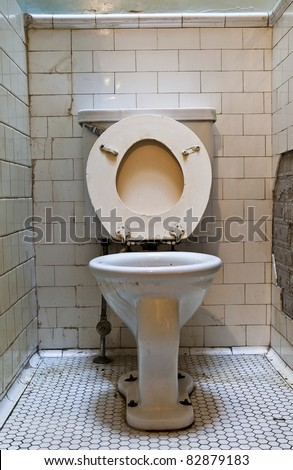 dirty old toilet bowl - stock photo