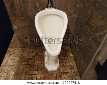 dirty old urinal in men's bathroom