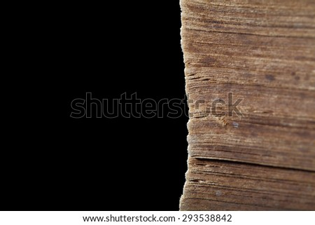 Dirty pages of old worn book isolated on black background - stock photo