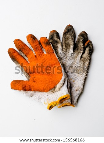 Dirty pair work gloves of canvas on white background - stock photo