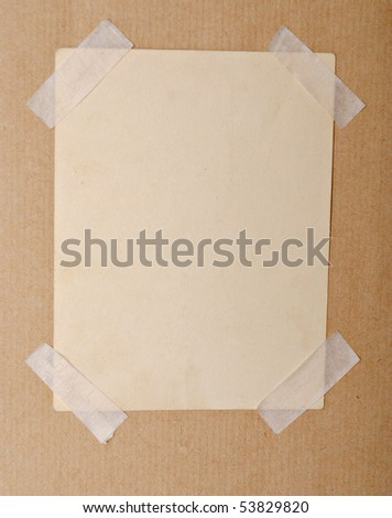 dirty piece of paper over brown cardboard background - stock photo