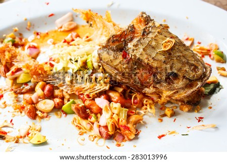 dirty plate on wooden table left after lunch. - stock photo